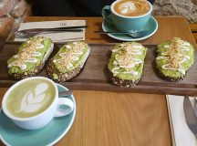 Avocado toast with tahini and crushed almonds with a matchahellip
