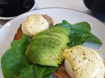 Delicious poached eggs with avocado spinach and hollandaise at Harvesthellip